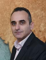 Paris Papanastasiou, Managing Director and CEO of IQ Solutions